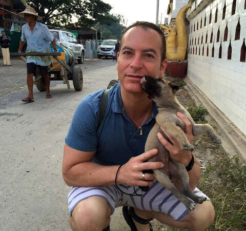 Arnold Plotnick and Stray Puppy in Myanmar